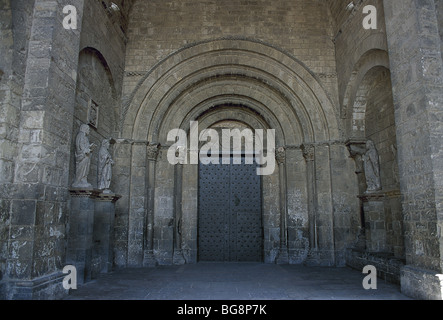 Saint Peter's Cathedral. Main gate or Saint Peter's portico with a monogram of Christ in the tympanum. Jaca. Aragon. - Stock Photo