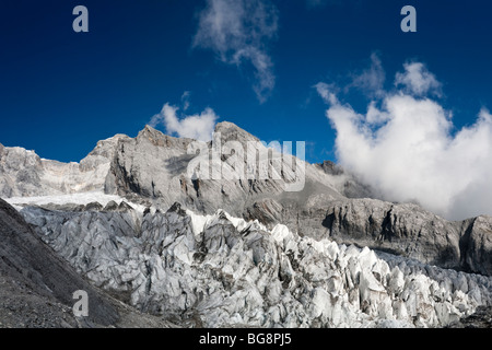 View of glacier on Jade Dragon Snow Mountain (Yulong Xueshan Mountain or Mt Satseto) from Dry Sea Meadow (Ganhaizi) - Stock Photo