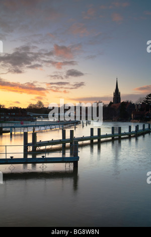 Sunset from Marlow lock on the River Thames looking towards the road bridge and the spire of All Saints Church, - Stock Photo