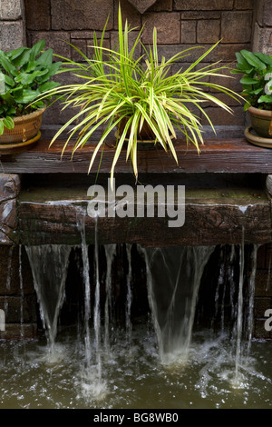 Garden water feature small waterfall - Stock Photo