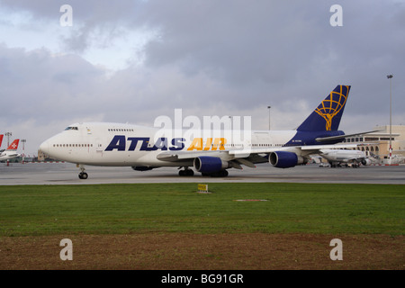 Atlas Air Boeing 747-200F taxiing for departure - Stock Photo