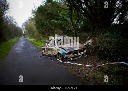 Burned out Vauxhall Astra. Stolen Car burnt out by joyriders - Stock Photo