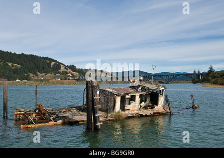 Shipwrecked boat Mary D. Hume at the mouth of the Rogue River in Gold Beach; southern Oregon coast. - Stock Photo