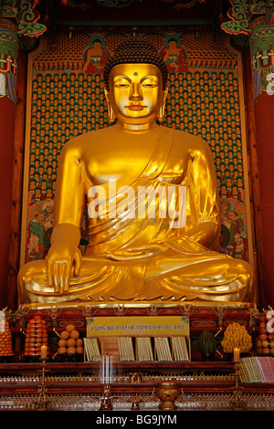 golden buddha inside the buddhist temple Jogyesa in South Koreas Capital Seoul, Asia - Stock Photo