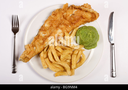Plate of Fish and chips and mushy peas - Stock Photo