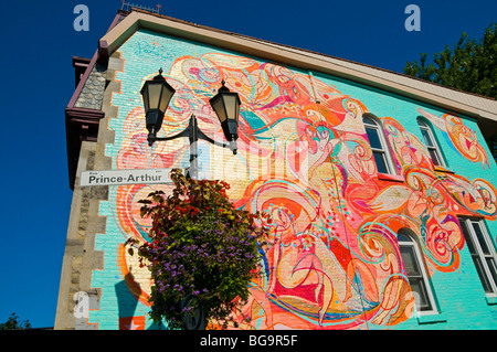 Wall Painting on a building Prince Arthur pedestrian street Plateau Mont Royal Montreal Canada - Stock Photo