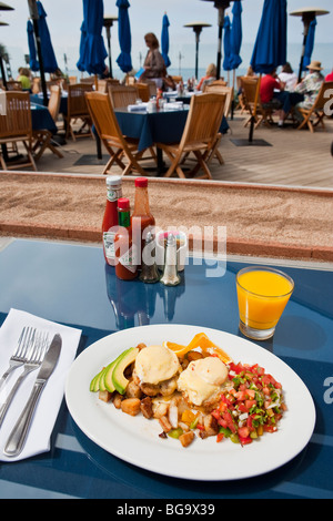 poached eggs, crab cakes, chipotle Hollandaise sauce, roasted potatoes, outdoor patio, Boathouse at Hendry's Beach, - Stock Photo