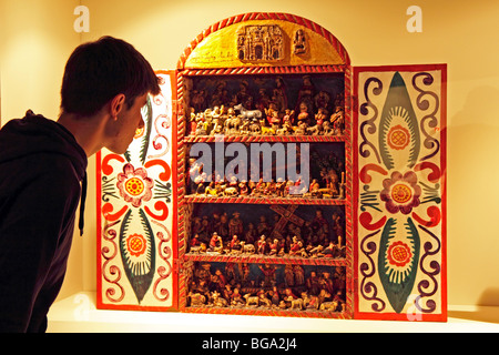 teenage boy looking at an altarpiece at the National Museum, Lima, Peru, South America - Stock Photo