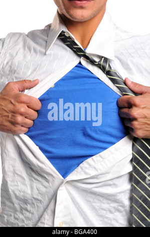 Businessman opening his shirt wearing a blue t-shirt underneath - Stock Photo
