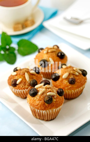 Muffins with blueberries and pine nuts. Recipe available. - Stock Photo
