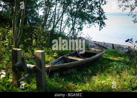 Old boats on the shore of the Kama River, Perm, Russia - Stock Photo