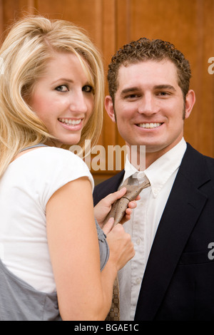 A young couple at home get ready for the workday. - Stock Photo