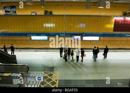 People waiting, walking underground on the platform of Taipei City Hall Metro Station in Taipei, Taiwan - Stock Photo