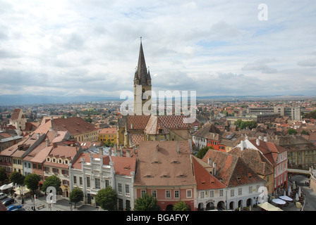 Romania, Transylvania, Sibiu, The old city, the steeple of the Evangical Church of Sibiu in the centre - Stock Photo