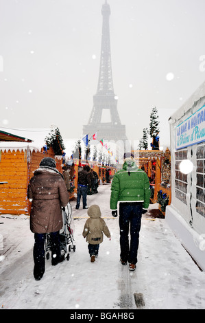 Paris, France, Family with CHildren, Walking Away, Winter Snow Storm, Christmas Market, 'Marché de Noel', near Eiffel - Stock Photo