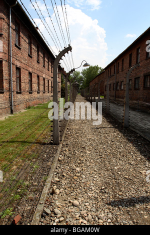Camp Buildings and security fencing at Auschwitz I Concentration Camp, Oświęcim, Poland - Stock Photo