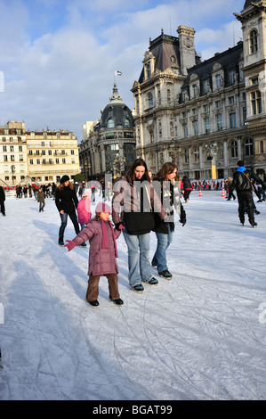 Paris, France, Young French Family, Children, Ice Skating, in Front of Paris City Hall - Stock Photo