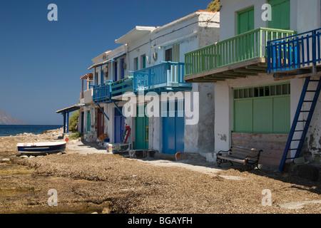 Syrmata - brightly painted fishermen's houses in Klima, Milos Island, Greece - Stock Photo