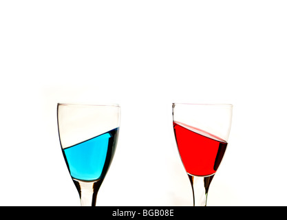 Red and blue liquid in wine glasses - Stock Photo