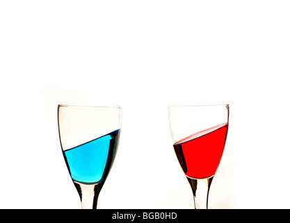 Blue and red liquid in wine glasses - Stock Photo