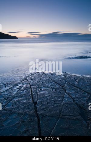 Dawn over Rocky Ledge at Kimmeridge Bay, Dorset - Stock Photo