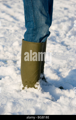 Wellington Boots In The Snow - Stock Photo