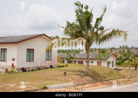 Company supplied housing near plantation. Employees can work towards purchase of their own home. Sindora Palm Oil - Stock Photo