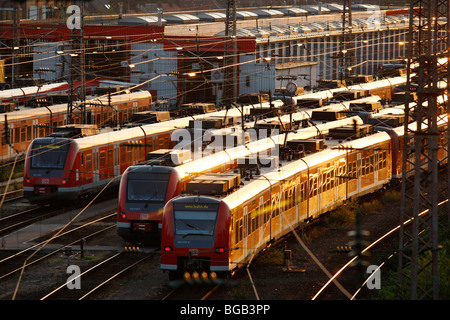 city trains on tracks in front of the central Station, Essen, Germany, Europe. - Stock Photo