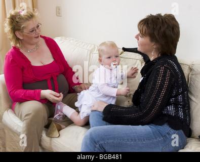 Housewives talking - SerieCVS417399c, third trimester pregnancy - Stock Photo