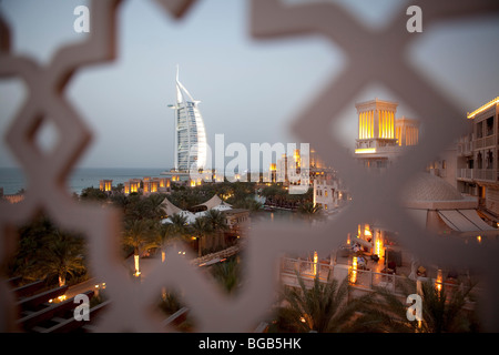Medinat Jumeirah hotel view to Burj al Arab at dusk, Dubai, United Arabian Emirates - Stock Photo