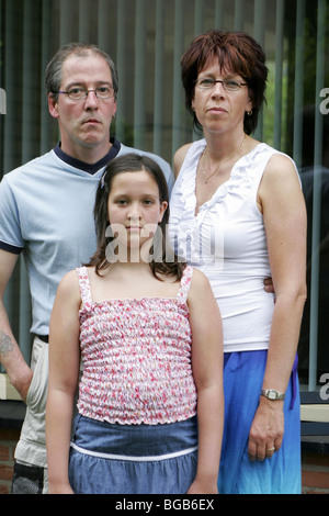 Family unit serious portrait standing in front of house - SerieCVS217070 - Stock Photo