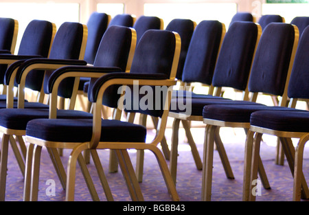 Photograph of rows seating wedding guests empty venue conference - Stock Photo