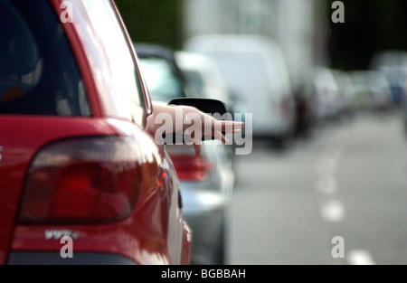 Royalty free photograph of woman in traffic jam congestion delay queuing bored M25 car - Stock Photo