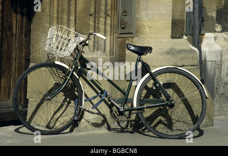 Old classic cruiser bicycle parked outside an old building - Stock Photo