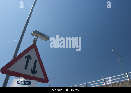 Two way traffic straight ahead UK road sign - Stock Photo