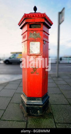An old Victorian red post box - Stock Photo