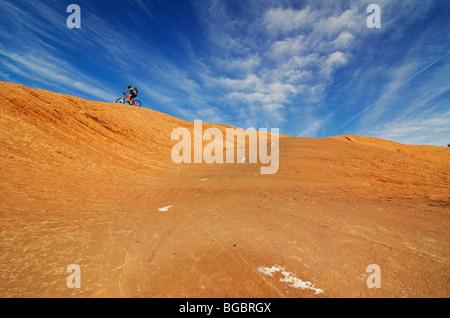 Mountain biker on Slickrock Trail, Moab, Utah, USA - Stock Photo
