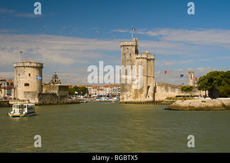Old harbour entrance with de la Chaine Tower on left and Saint Nicolas Tower on right, La Rochelle, Charente-Maritime, - Stock Photo