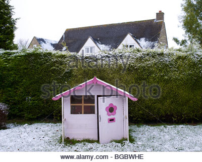 Wendy house in the snow - Stock Photo