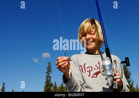 Boy fishing, British Columbia, Canada - Stock Photo