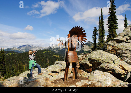Child photographing a Native American iron chief, Mt. Revelstoke, Meadows in the Sky, Revelstoke National Park, - Stock Photo