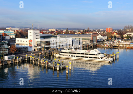 View of the Graf Zeppelin Museum, and the docks of the Bodensee Schifffahrtsbetriebe Lake Constance fleet in Friedrichshafen, - Stock Photo