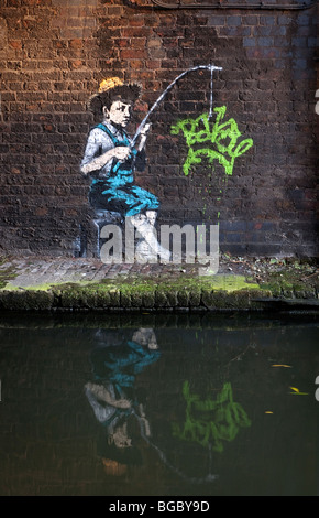 Banksy image of Huckleberry Finn character New graffiti in Camden Lock on Grand Union cannal London UK. - Stock Photo