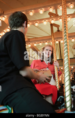 On a carousel ride - Stock Photo