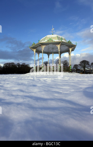 The Victorian traditional bandstand in Duthie Park in Aberdeen, Scotland, UK, seen in the snow in winter - Stock Photo