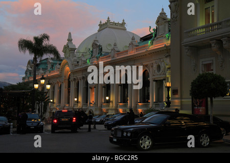 Casino Monte Carlo in the dusk, east wing with the gambling halls, architect Charles Garnier, a black Bentley on - Stock Photo