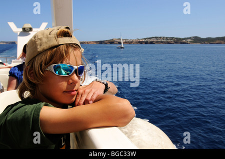Boy on a tour boat, Ibiza, Pine Islands, Balearic Islands, Spain, Europe - Stock Photo