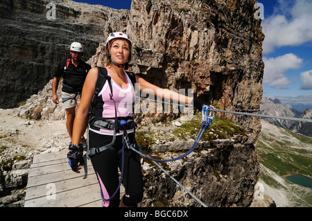 Climbers on fixed rope route onto Paterno, Alta Pusteria, Sexten Dolomites, South Tyrol, Italy, Europe - Stock Photo