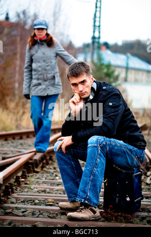 Couple on rail track - Stock Photo