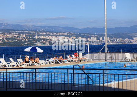 Swimming pool in Opatija in front of the city Rijeka with the Gorski Kotar Mountains in the distance, Istria, Croatia, - Stock Photo